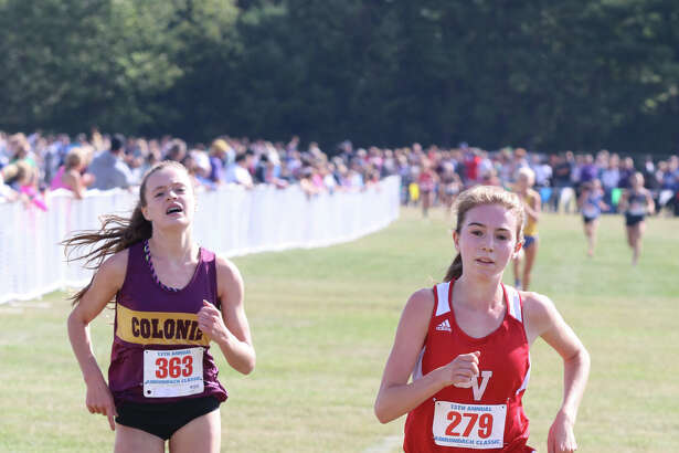 Sophia Gorman of Vermont's Champlain Valley Union High School and Colonie's Kathryn Tenney finish 1st and 2nd in the Girls Division 1 varsity race during the Queensbury Invitational cross country meet at Queensbury High School Saturday, September 17, 2016. (Ed Burke/Special to The Times Union)