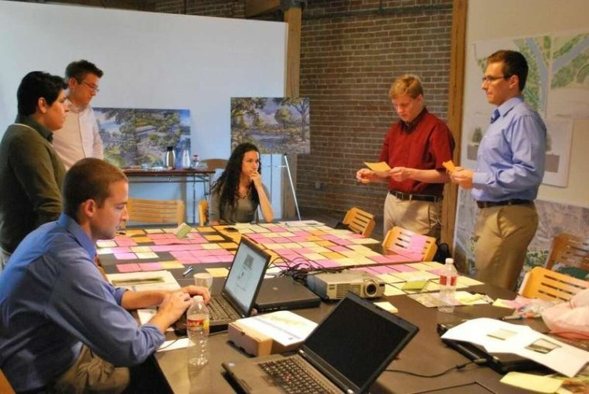 The Pariveda Solutions Intern Team at work on the Buffalo Bayou Trail Guide mobile application.