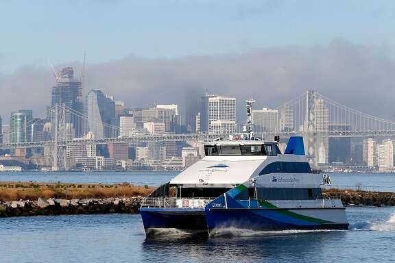 A San Francisco Bay Ferry approaches the Port of Oakland in Oakland, Calif. on Wednesday, Sept. 28, 2016.