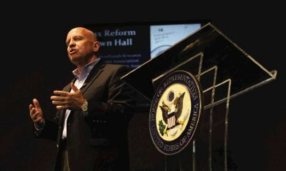 U.S. Representative Kevin Brady speaks during a town hall meeting a Gateway Baptist Church Thursday. Brady talked about the federal tax code and took questions from the audience. / Conroe Courier