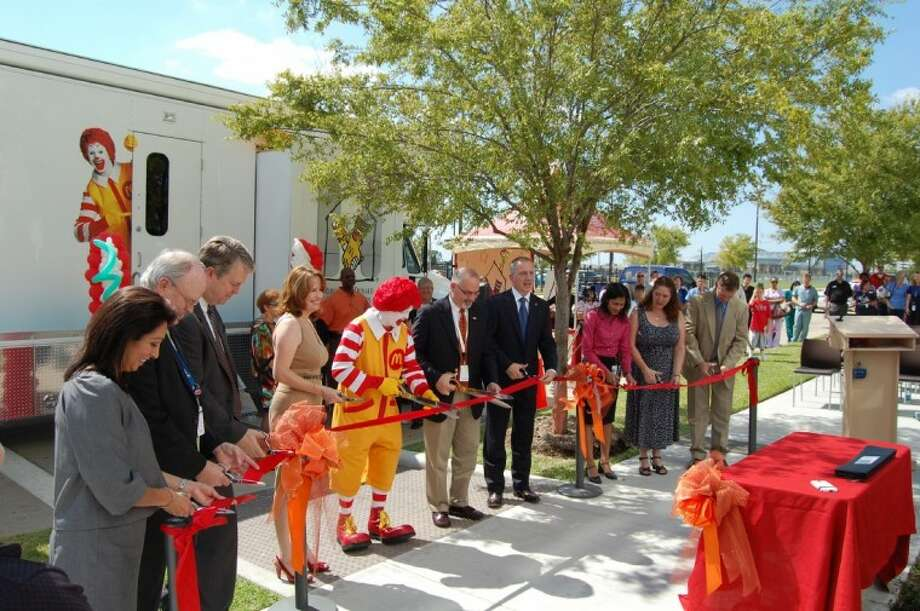 Leaders from UTHealth and Ronald McDonald House Charities of Greater Houston/Galveston cut the ribbon Oct. 5 on the new Ronald McDonald Care Mobile. Photo: Submitted Photo