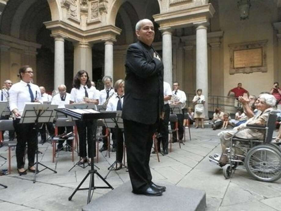 Dr. Glenn Garrido, new chair of the Music Department at the University of St. Thomas, started his semester by conducting the Civic Orchestra of Milan on Sept. 8 at the Court of Honor of the City Palace, or Palazzo Marino, in Milan, Italy. Garrido was the first U.S. citizen to guest conduct the more-than-150-year-old Orchestra. Photo: Submitted Photo