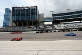 FORT WORTH, TX - JUNE 12:  Cars race through turn one during the Verizon IndyCar Series Firestone 600 at Texas Motor Speedway on June 12, 2016 in Fort Worth, Texas.  (Photo by Matt Hazlett/Getty Images for Texas Motor Speedways)