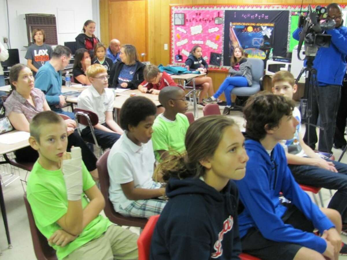 Houston students, their families and teachers gathered at Johnston Middle School to watch the launch of the SpaceX Dragon capsule, which is taking scientific experiments and a mission patch they created last year to the International Space Station. Among them are, in back from left, Max Denning, Aaron Stuart, Michael Prince, and in front from left, Allie Burns, Austin Abbott and Sebastian Beil.