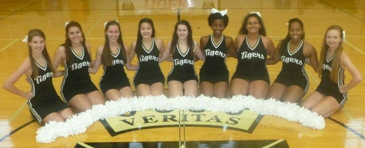 The St. Agnes Academy Tiger Girls dance team (officers pictured here), led by Coach Julie Chilton, has been selected to rock out with the Houston Rockets at a pregame performance on Wednesday, Dec. 12, at the Toyota Center. The 43-member squad will also take to the field for the Houston Texans Cheerleaders All Star event at halftime of the Texans vs. Jacksonville Jaguars game at Reliant Stadium on Sunday, Nov. 18. The team's expanded performance dates will also include halftime entertainment at several Strake Jesuit as well as St. Agnes Academy basketball games this season.