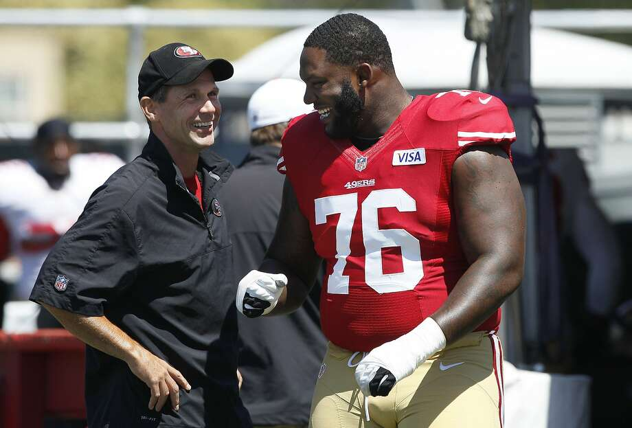 General manager Trent Baalke and right tackle Anthony Davis during training camp in 2012. Photo: Jeff Chiu, Associated Press