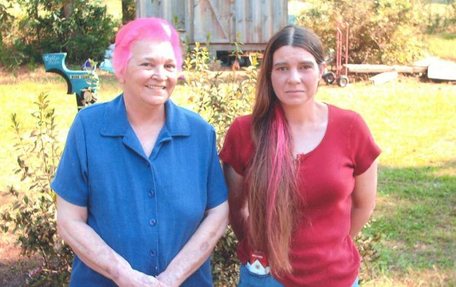 Joann Ott and her daughter, Kam Smith, dyed their hair with pink after Ott was diagnosed with breast cancer. Ott eventually lost her hair when she started chemotherapy. In total, 11 other men and women dyed their hair or parts of their beards pink in support of Ott.