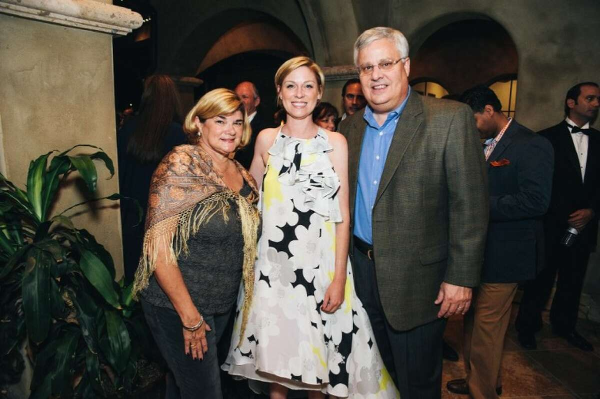 From left, Michelle Leigh Smith, State Rep. Sarah Davis (R-134) and husband Kent Adams enjoy an evening outdoors after hearing a performance from the Houston Grand Opera at 'An Evening in Italy,' a themed-fundraiser for PATRONS for Bellaire Parks.