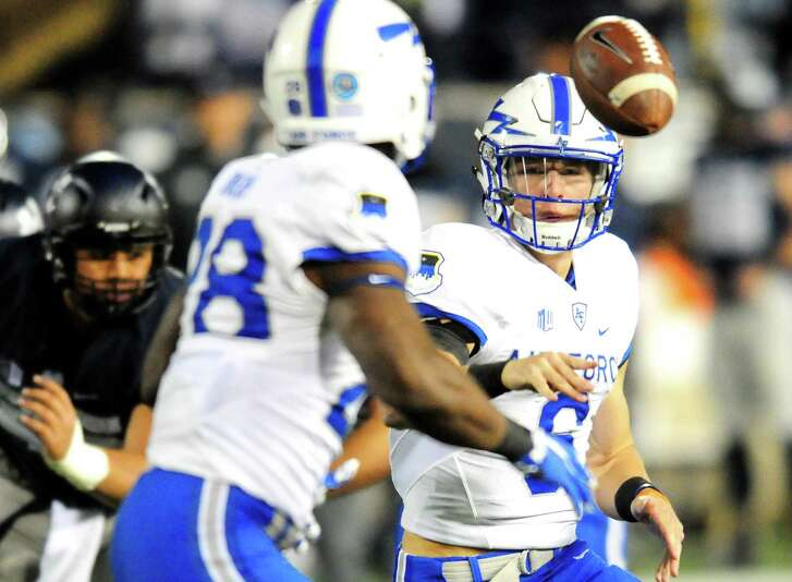 Air Force's Nate Romine pitches the ball off to Jacobi Owens against Utah State on Sept. 24, 2016, in Logan, Utah.