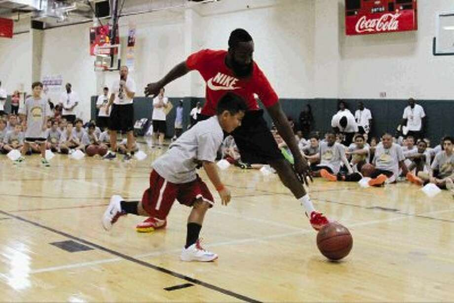 Houston Rockets guard James Harden chases down a loose ball during a game of one-on-one at the James Harden Basketball ProCamp at Legends Sports Complex. Go to HCNPics.com to view more photos. / Conroe Courier