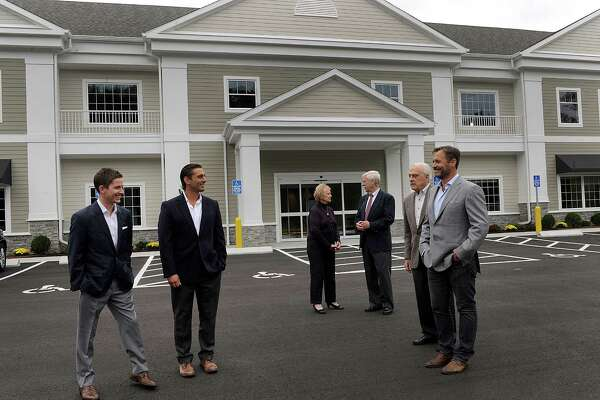 Maplewood Healthcare has opened a new facility at 170  Mt. Pleasant Rd in Newtown, Conn. An open house on Thursday, Sept. 29, 2016, is attended by from left, Corban Tomlinson, Chris Romano, Newtown First Selectwoman Pat Llodra, Wes Thompson, Bob Rau and Maplewood Healthcare CEO Chris Smith.
