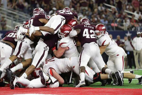 The Texas A&M defense makes a goal-line stand against the Arkansas Razorbacks in the third quarter at AT&T Stadium on Sept. 24, 2016 in Arlington.