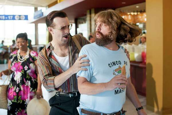 "Jason Sudekis (left) is a hit man on Zach Galifianakis' trail in the film ""Masterminds."""