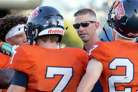 Brandeis coach Jeff Fleener talks to his players before their game against Boerne Champion at Farris Stadium on Sept. 9, 2016.