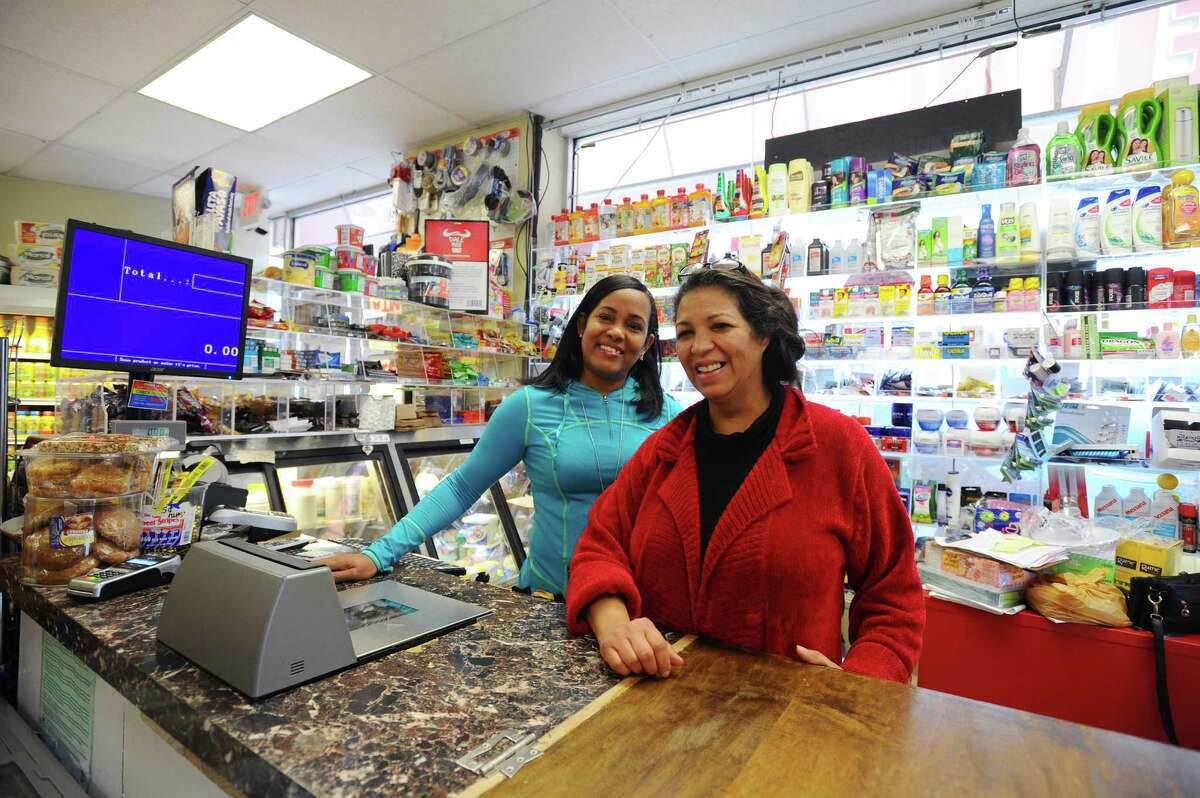 Stamford Deli Grocery LLC owner Yanile Cepeda, right, and Milagros Rivera inside their store in Stamford, Conn. on Thursday, Sept. 29, 2016.