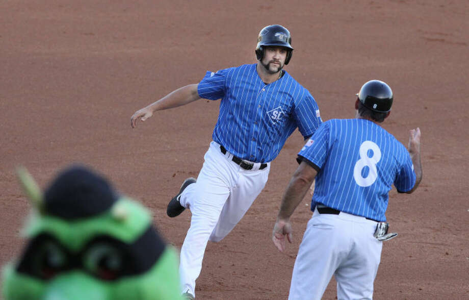 Sugar Land Skeeters Ryan Langerhans rounds third after a home run during Turn Back the Clock Night against the Long Island Ducks Aug. 9 at Constellation Field in Sugar Land.