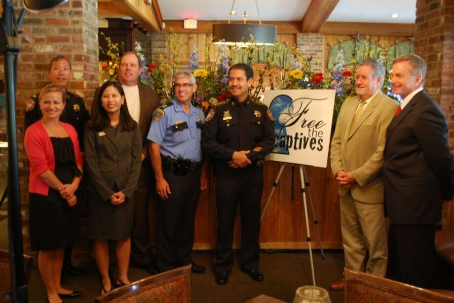 """Officials of the Harris County Sheriff's Office, Houston Police Department and the Precinct 4 Constable's Office were recognized by the """"Free the Captives"""" Anti-Human Trafficking Association for their influence and interest in fighting sex trafficking. Photo: Courtesy Harris County Sheriff's Office"""