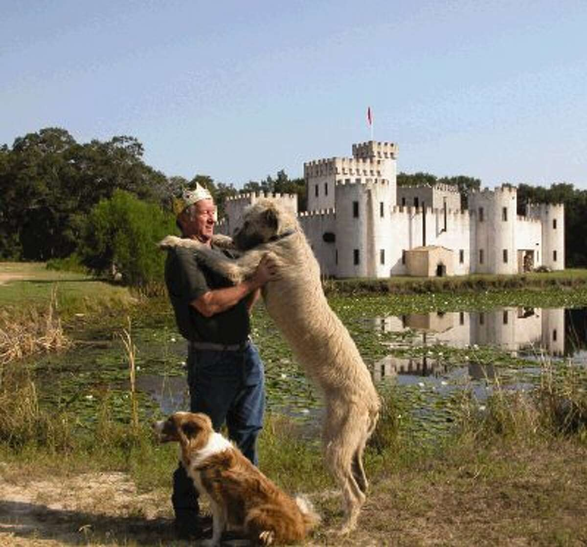 Mike Newman created this castle in the country near Bellville. He built the castle with one helper and it took approximately eight years to complete. Now the castle is open for tours and events. Newman is pictured here with his canine companions. Avalon is the one that stands nearly as tall as Newman.