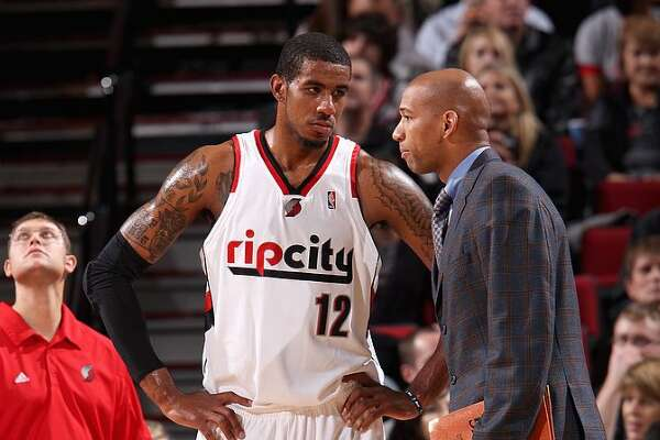 PORTLAND, OR - NOVEMBER 6: LaMarcus Aldridge #12 listens to assistant coach Monty Williams of the Portland Trail Blazers during the game against the San Antonio Spurs on November 6, 2009 at the Rose Garden in Portland, Oregon. The Blazers won 96-84.
