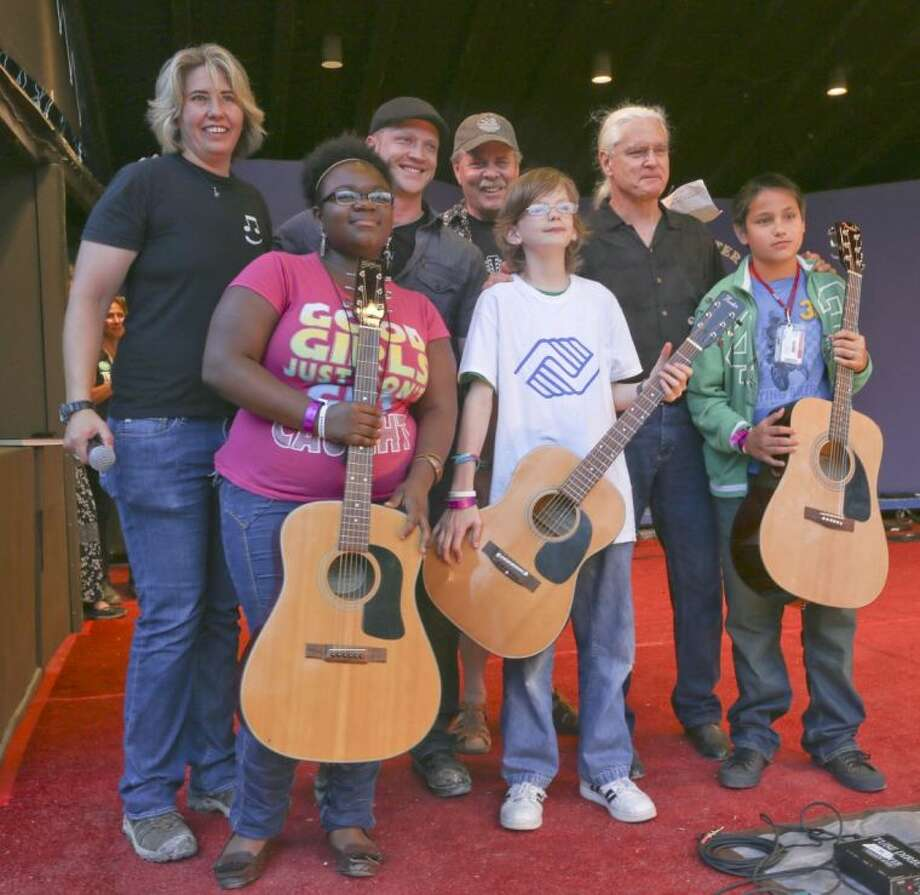 Acoustic guitars donated to Boys and Girls Clubs Summer Music Camp at Kerrville Folk Festival.
