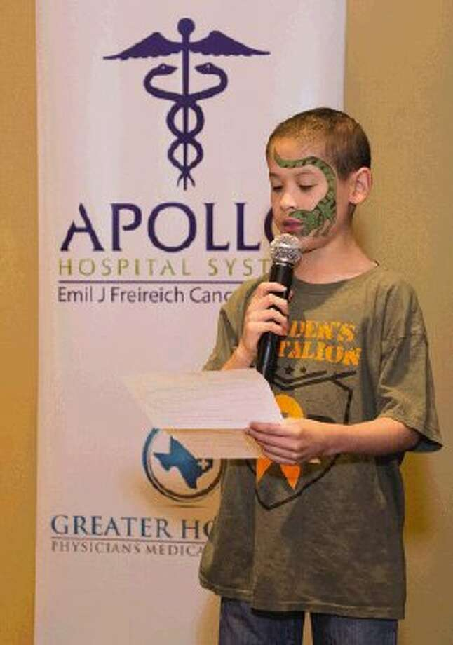 Cancer survivor Braden Murray, complete with a face-painted dragon, addresses attendees of the Montgomery County Light the Night Walk kickoff rally Aug. 22.