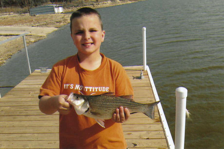 Keatyn Eitelman of Pottsboro caught this 16.5-inch white bass from Lake Texoma on December 2, 2012, the second fish of five he needed to achieve Elite Angler status. Photo: Nailen Eitelman