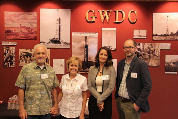 Members of the Davis family attended an open house celebrating Great Western Drilling's 80th anniversary: Kevin and Alana Davis Marsh, from left, Ken Davis Sr.'s granddaughter, and Jeniece Davis Sanders and Alan Davis, Davis' great-grandchildren.
