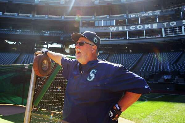 Mariners head groundskeeper Bob Christofferson directs his crew as they set up equipment for batting practice before a game against the Toronto Blue Jays, Sept. 20, 2016 at Safeco Field.
