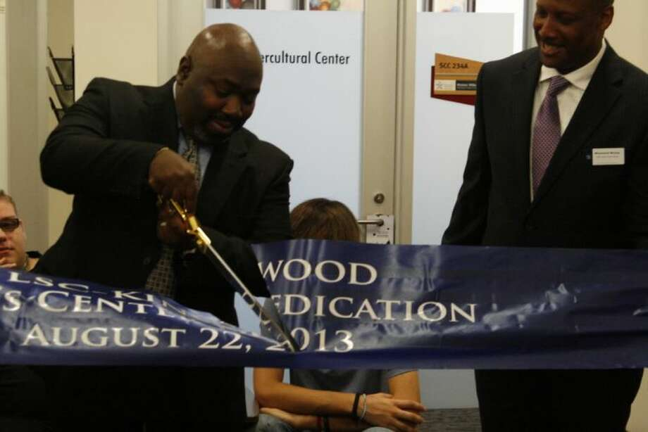 Dr. Darrin Rankin, vice president of student success at LSC-K, cuts the ribbon at the opening ceremony of Lone Star College-Kingwood's Men's Center Aug. 22, 2013.