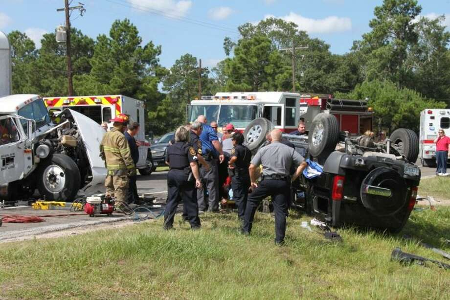 Emergency crews had to use the jaws of life to remove 19-year-old Tarkington resident Cristin Purswell from her vehicle. She was trapped inside her overturned Hummer SUV for a half-hour while crews expanded the compartment that was trapping part of her body in the vehicle.
