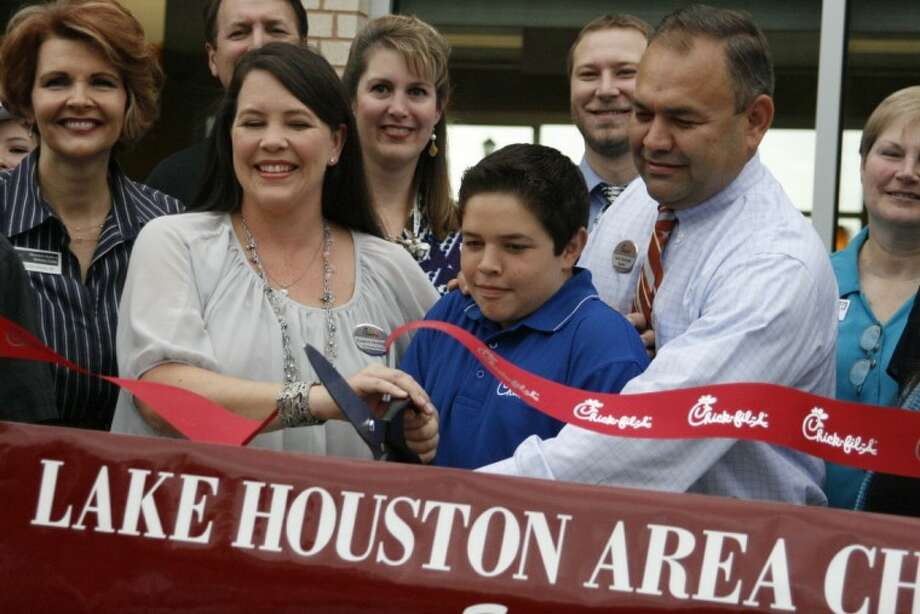 Zack Derelioglu and his wife, Suzanne and son, Conner, had the chance to cut the ribbon during the grand opening celebration of the new Chick-fil-A in Kingwood Oct. 25.