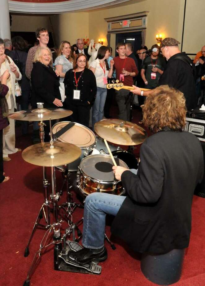 "The band Fairly Famous entertained guests during a party Tuesday after the screening of ""The Wrecking Crew"" at The Connecticut Film Festival. The event was a benefit for Ability Beyond Disability, which partnered with The Connecticut Film Festival at the Palace Theatre on Main Street in Danbury. Photo: Lisa Weir / The News-Times Freelance"
