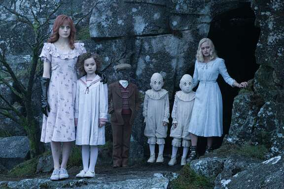"""In this image released by 20th Century Fox, from left, Lauren McCrostie, Pixie Davies, Cameron King, Thomas and Joseph Odwell and Ella Purnell appear in a scene from, """"Miss Peregrine's Home for Peculiar Children"""".  (Jay Maidment/20th Century Fox via AP)"""