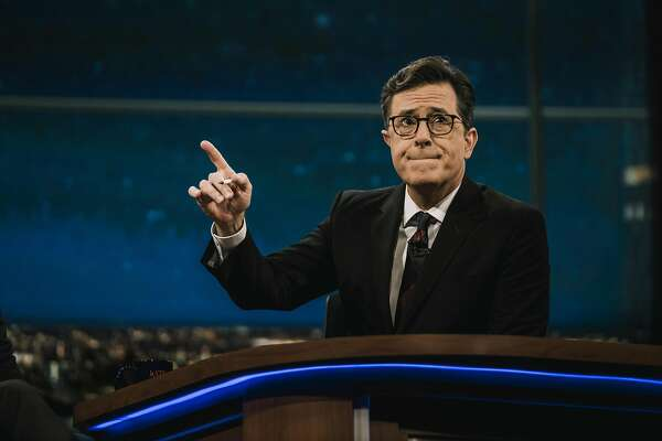 """Stephen Colbert broadcasts """"The Late Show� live after the first presidential debate, at the Ed Sullivan Theater in New York, Sept. 26, 2016. Putting on a live episode of �The Late Show� can be a mad rush, with fresh jokes replacing previously-rehearsed bits and no time for second-guessing. �I will do anything, as long as I have enough time to read it through once,� Colbert said. (Christopher Gregory/The New York Times)"""