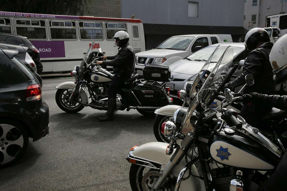 San Francisco Police Officers pull out onto Folsom street to participate in a demonstration for the media meant to catch speeders Sept. 29, 2016 in San Francisco, Calif. SFPD along with SFMTA and Vision Zero announced a renewed effort to catch city speeders by the SFPD.
