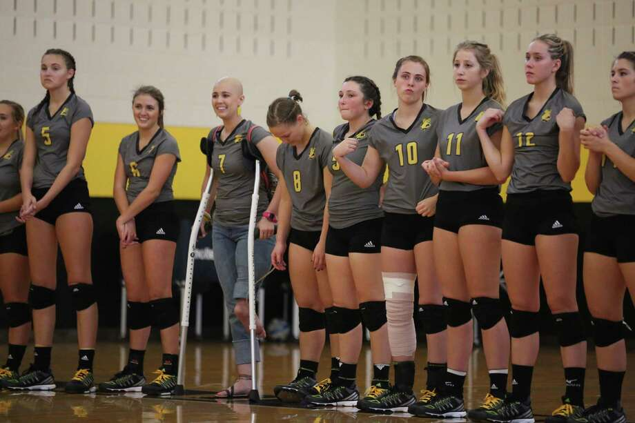 Former Texas Lutheran University volleyball player Jillian Williams is battling cancer and underwent an extraordinary surgery amputated her leg and attached her ankle and foot backward to serve as a workable joint for a future prosthetic. Williams is not enrolled in school this year and so she is not technically a part of the official Bulldogs team this year. But she has joined the team on the bench for a few matches this season. Photo: Courtesy Photo /Texas Lutheran Athletics