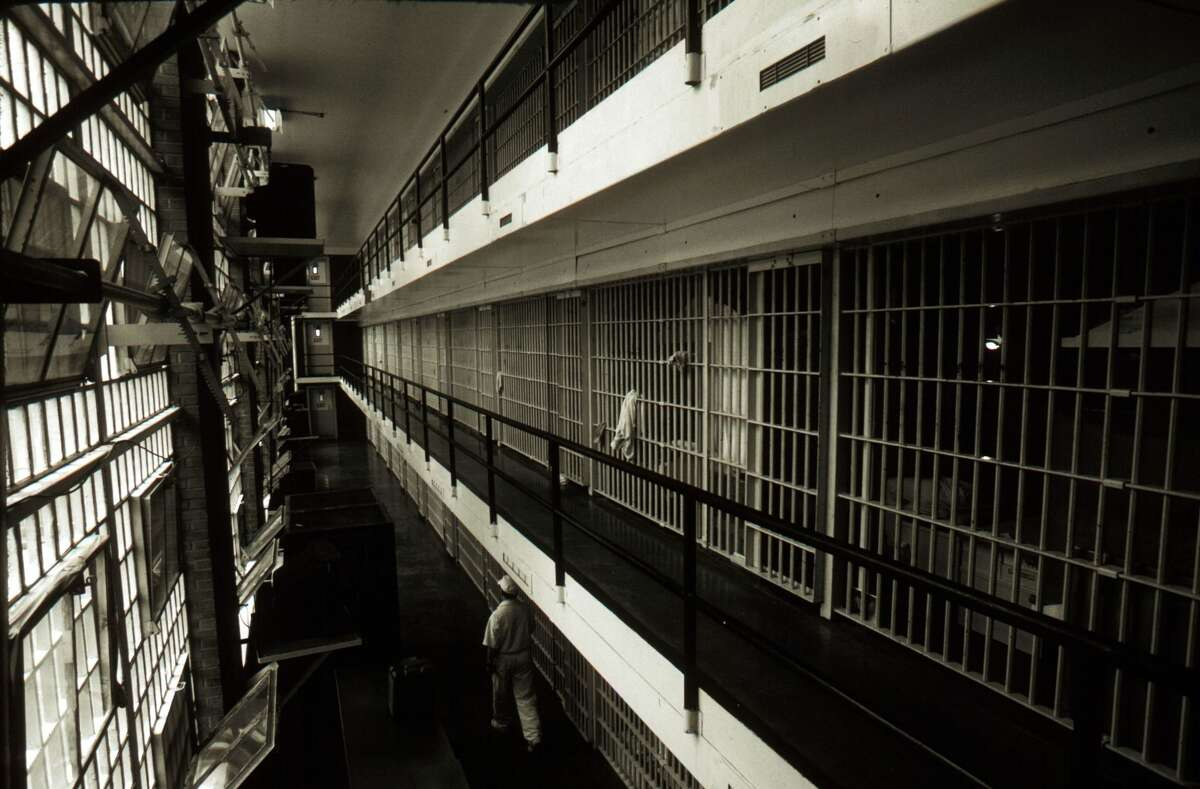Prison cells line a hall at the Ellis death row unit April 16, 1997 in Huntsville Prison in Huntsville, Texas. The state has about 450 prisoners on death row. Texas executes more prisoners than any other state in the US.