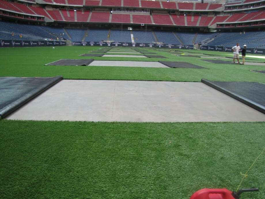 Houston's Reliant Stadium becomes the first stadium to have natural grass and AstroTurf playing surfaces in order to host more events.