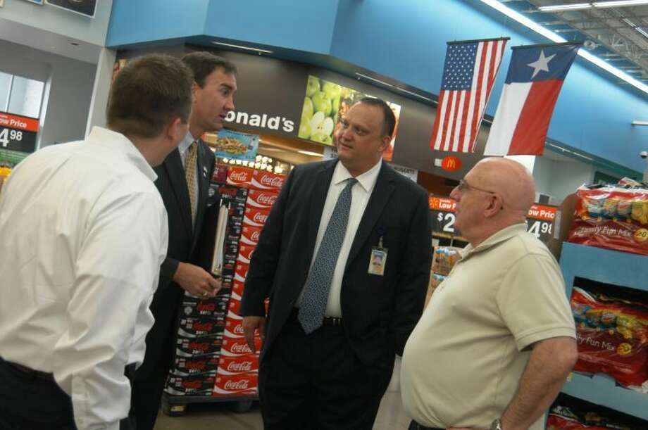 Olson speaks with a Walmart customer and Constituent during his recent visit to the Richmond store location. (L-R: Chris E. Nelson, Walmart, Market Manager; Congressman Pete Olson; Todd Manley, Walmart, Regional General Manager, Operations - Region 6; TX-CD 22 Constituent)