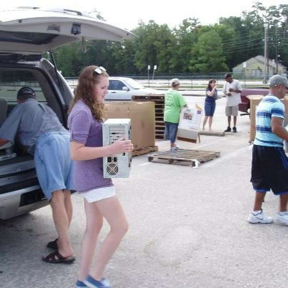 Rebecca East recycles electronic waste at the Kingwood Metro Park-and-Ride lot.