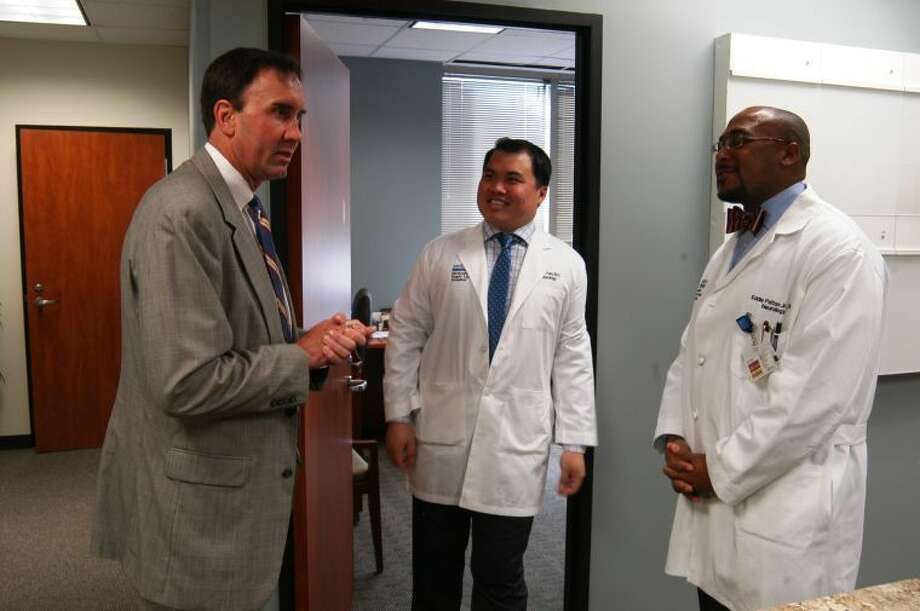 Congressman Pete Olson speaks with Dr. Larry Tran and Dr. Eddie Patton of Sugar Land Neurology Associates at Methodist Hospital in Sugar Land.