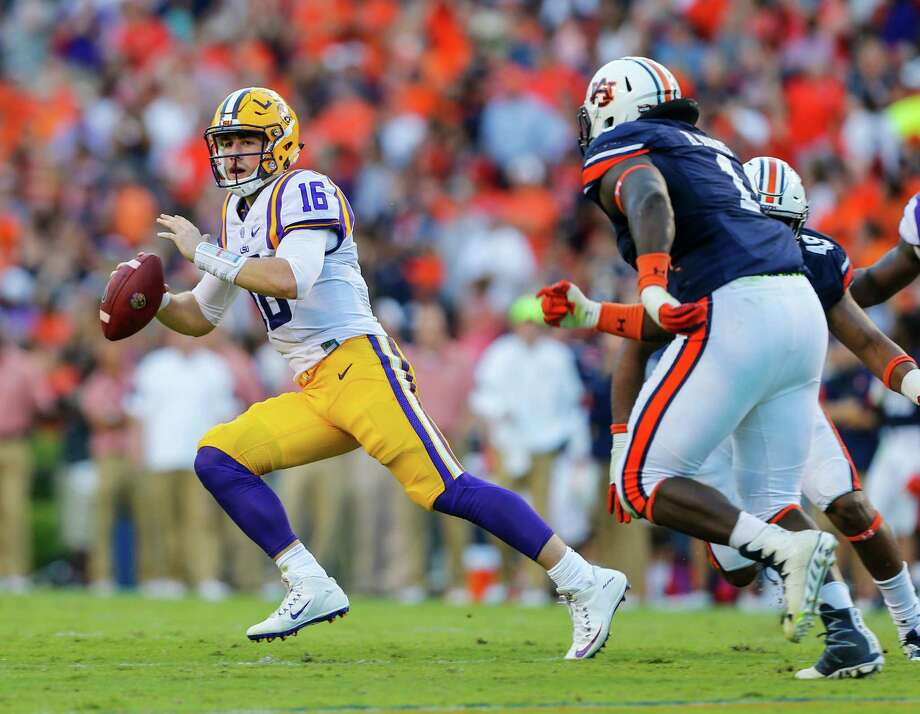 LSU quarterback Danny Etling (16) scrambles away from pressure from Auburn defensive tackle Montravius Adams (1) during the first half of an NCAA college football game, Saturday, Sept. 24, 2016, in Auburn, Ala. (AP Photo/Butch Dill) Photo: Butch Dill, FRE / Associated Press
