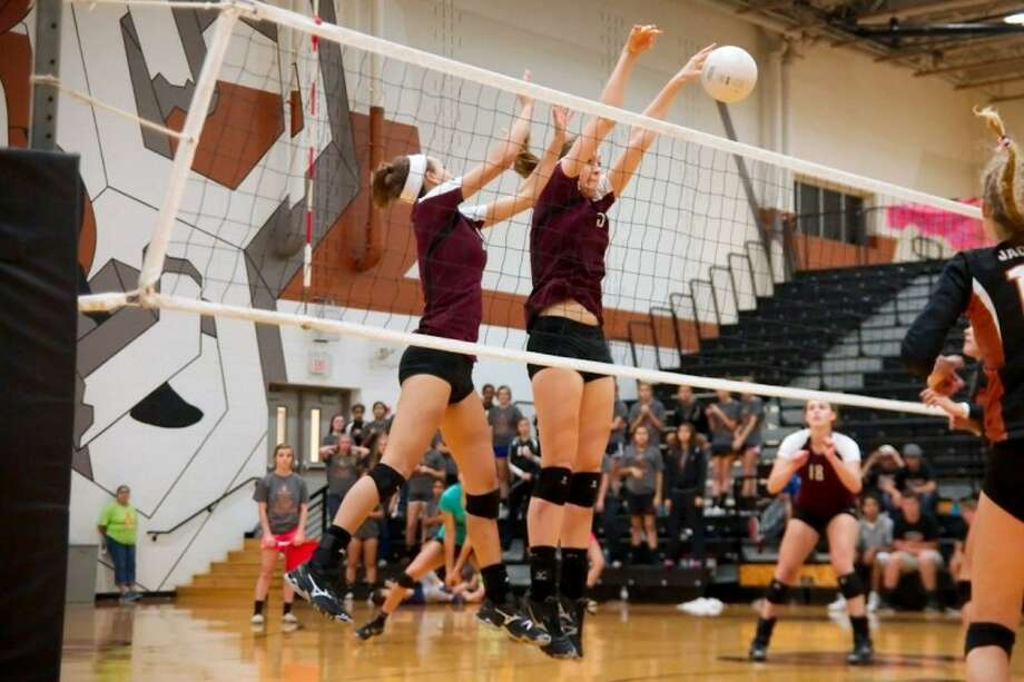 Cassidy Nussman of Pearland blocks an attack from Alvin for a Lady Oiler points in a match earlier this year.