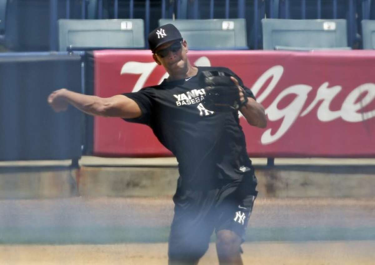 New York Yankees third baseman Alex Rodriguez throws the ball during a rehabilitation workout on Thursday at Steinbrenner Field in Tampa, Fla.