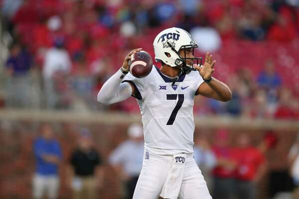 DALLAS, TX - SEPTEMBER 23:  Kenny Hill #7 of the TCU Horned Frogs looks for an open receiver against the Southern Methodist Mustangs in the first quarter at Gerald J. Ford Stadium on September 23, 2016 in Dallas, Texas.  (Photo by Tom Pennington/Getty Images)