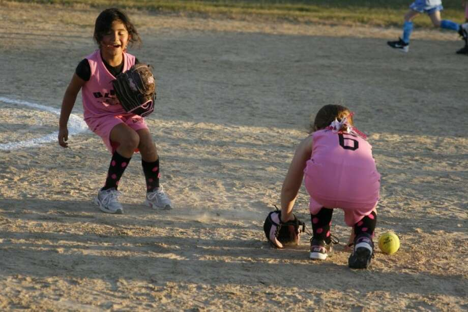 Kingwood Girls' Softball Association tee-ball team plays a game at their fields before the sun sets. Vandals hit the fields among others through the Kingwood area breaking into their junction boxes and stripping the electrical wires to steal copper.