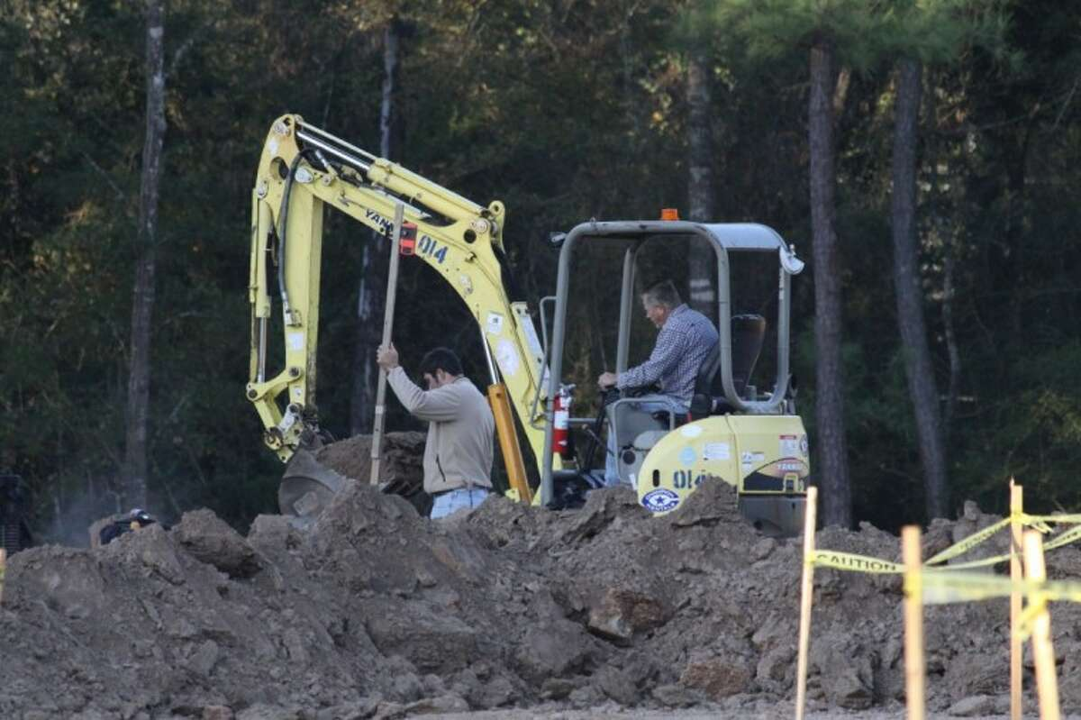 Crews work at the site of a 20,000-square-foot building that will be part of a 10-acre development at Six Pines Drive and Research Forest Drive. Located in Shenandoah, the development will border The Woodlands.