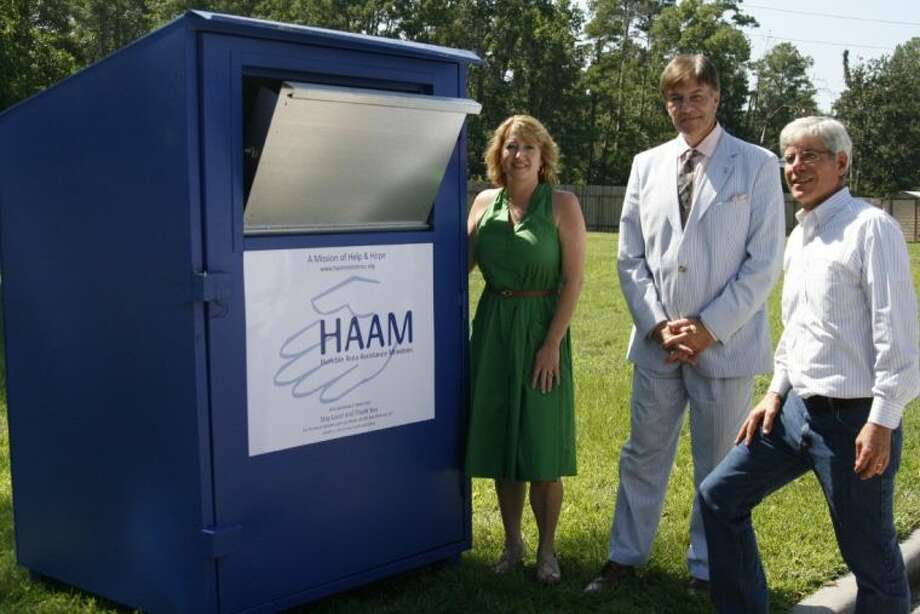 HAAM recently partnered with Christ the King Lutheran Church in Kingwood to place a donation box behind the church to make it easier for residents to donate their clothing and other items. Shown from left are Millie Garrison, HAAM's assistant executive director; Jim Randall, HAAM's executive director, and Doyle Theimer, Christ the King Lutheran Church associate pastor, with one of the new donation boxes.