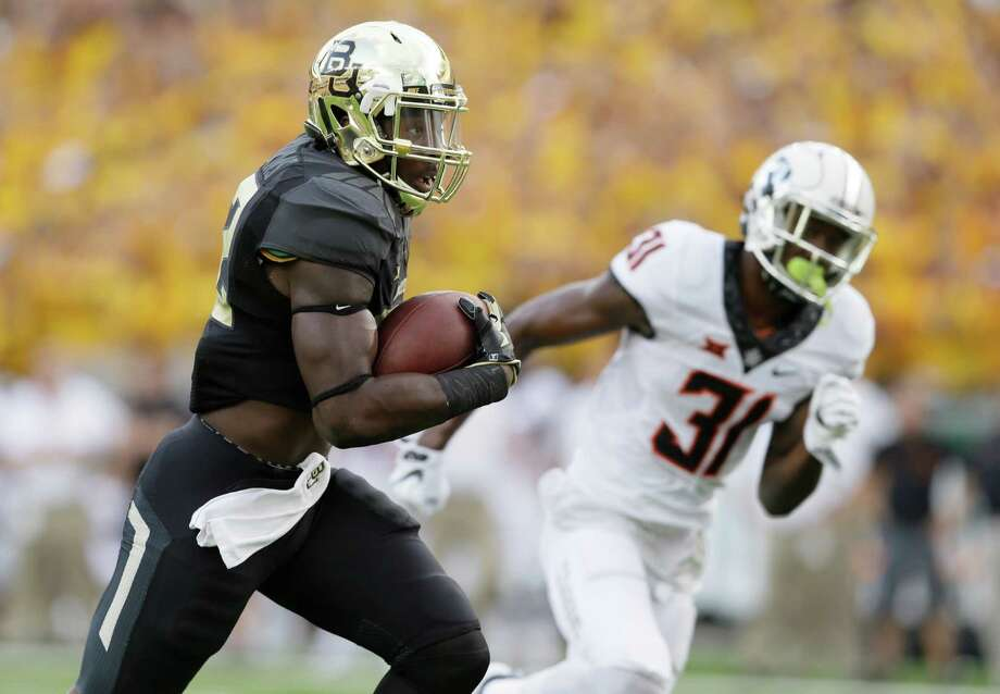 Baylor running back Terence Williams (22) runs for a touchdown against Oklahoma State safety Tre Flowers (31) during the first quarter of an NCAA college football game Saturday, Sept. 24, 2016, in Waco, Texas. (AP Photo/LM Otero) Photo: LM Otero, STF / Copyright 2016 The Associated Press. All rights reserved.