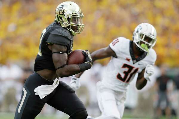 Baylor running back Terence Williams (22) runs for a touchdown against Oklahoma State safety Tre Flowers (31) during the first quarter of an NCAA college football game Saturday, Sept. 24, 2016, in Waco, Texas. (AP Photo/LM Otero)